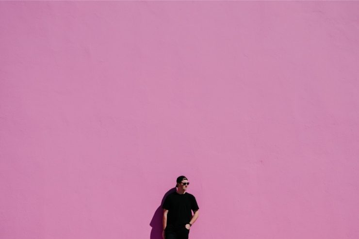 Man against pink wall